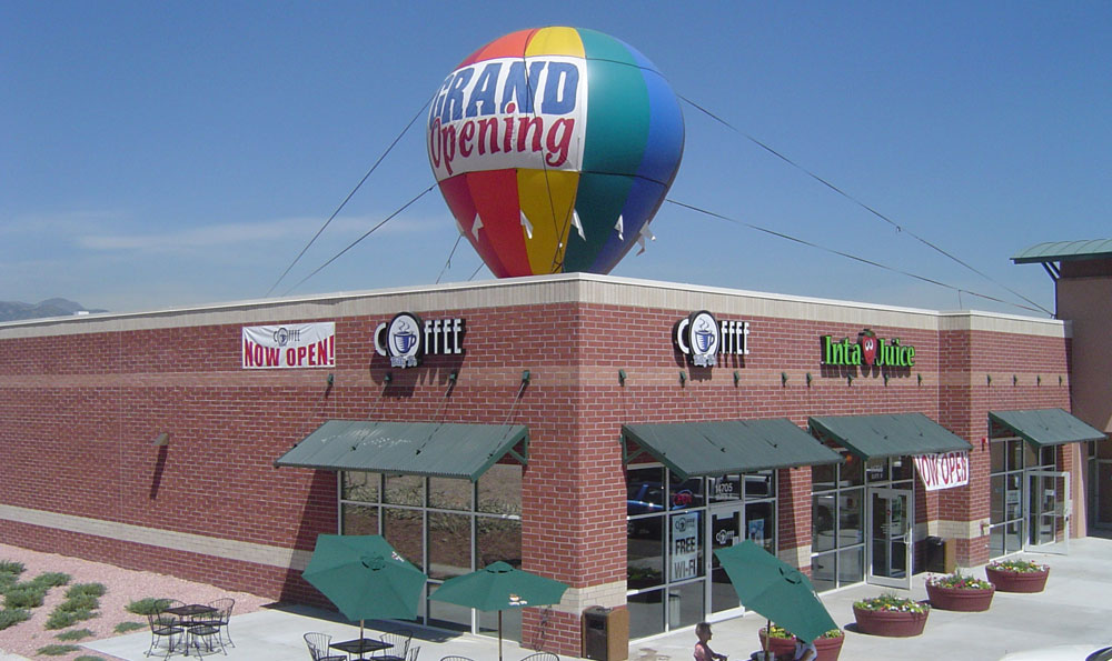 Balloon Inflatable over Coffee Shop.  Text: Grand Opening