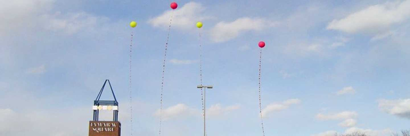 Four balloons as advertisement for Tamarac Square.