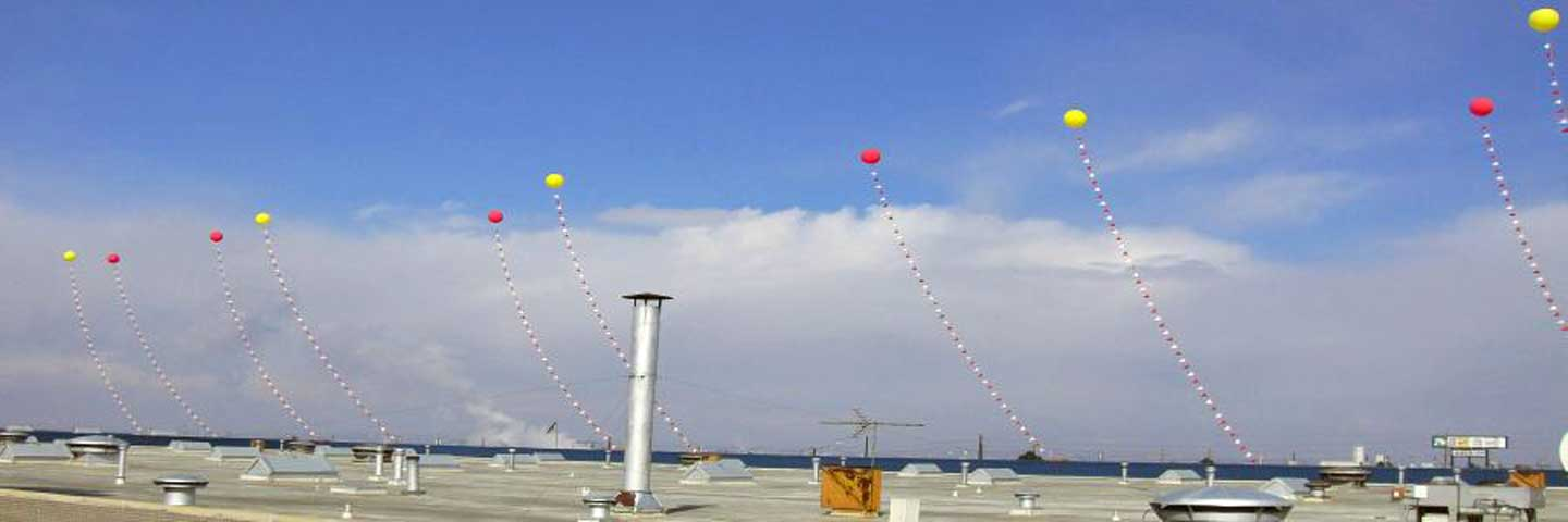 Ten helium balloons serve as a impressive promotional rooftop display.