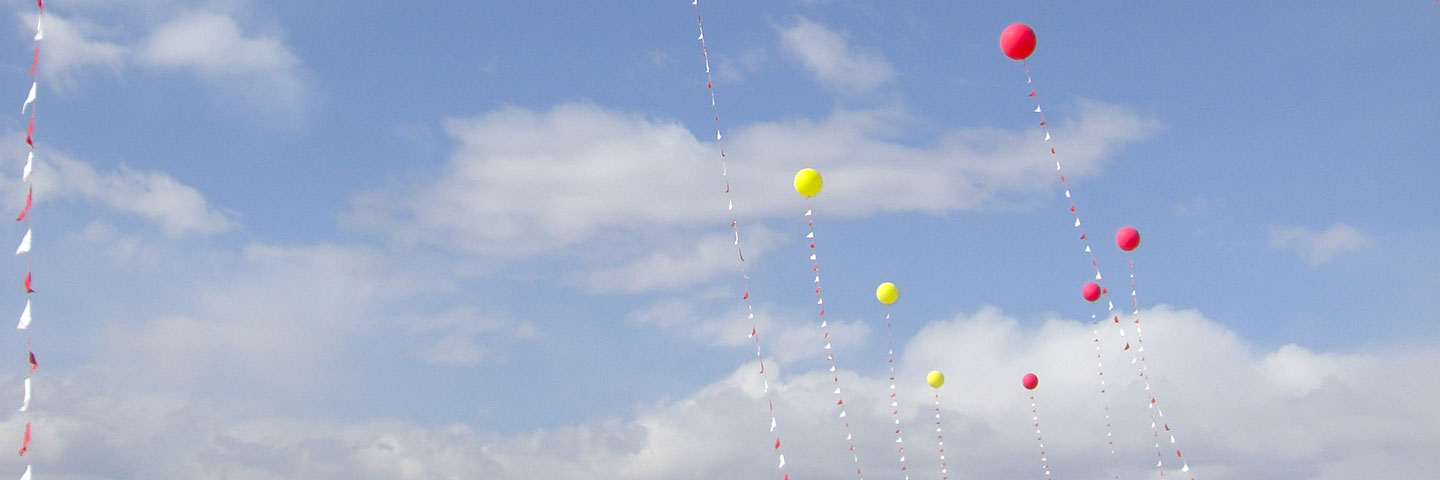 Helium Balloons in the Skywith Pennants