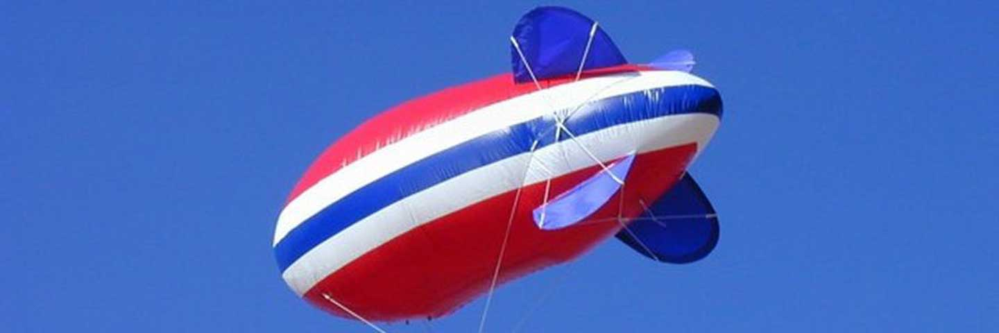 Red White and Blue Advertising Blimp