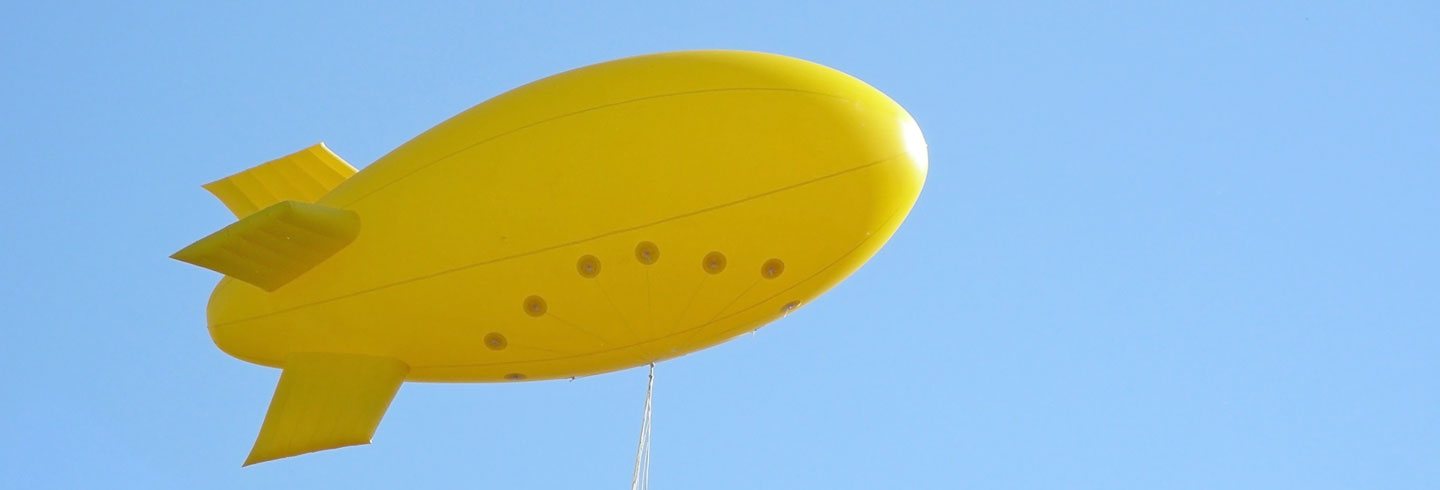 Yellow Tethered Helium Blimp