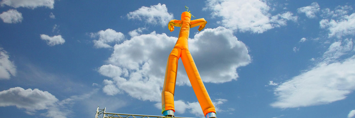 Orange Dancing Inflatable Tube Sky Dancer in Bright Sunlight