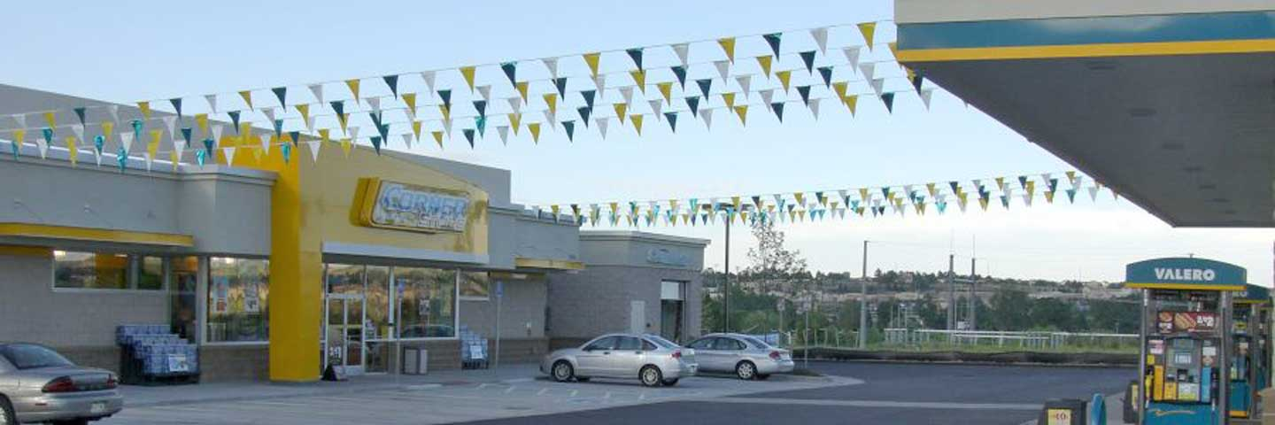 Promotional Pennants Advertising at a Gas Station