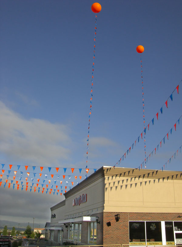Balloons and Pennants against Blue Sky