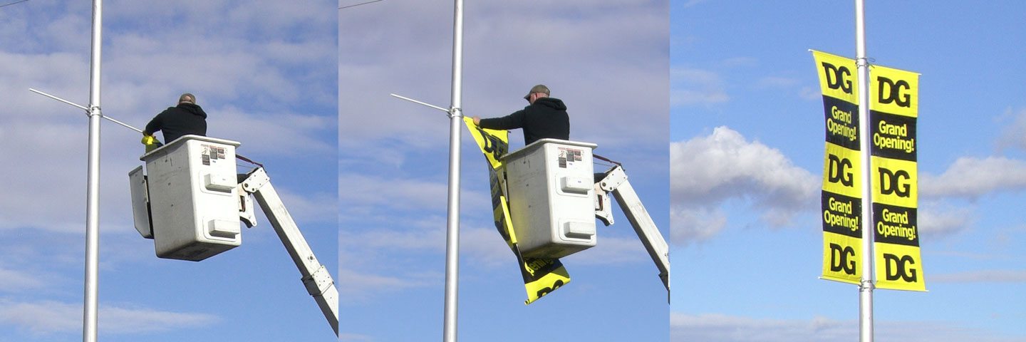 Installation of a Vertical Banner with a Bucket Truck on a Lamp Post in Wray, Colorado